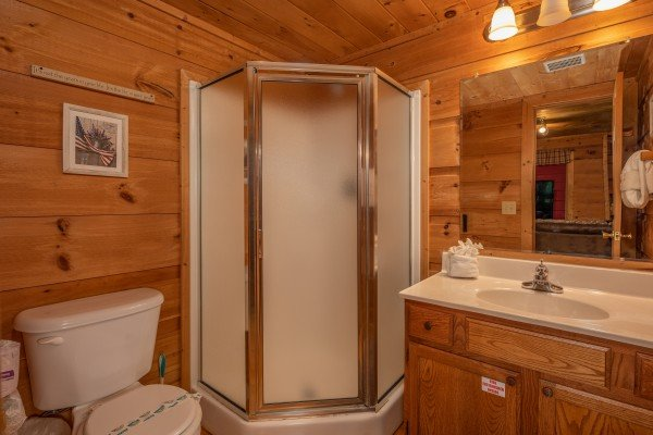 Bathroom with a corner shower at Logan's Smoky Den, a 2 bedroom cabin rental located in Pigeon Forge