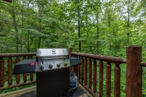 Grill on the deck at Logan's Smoky Den, a 2 bedroom cabin rental located in Pigeon Forge