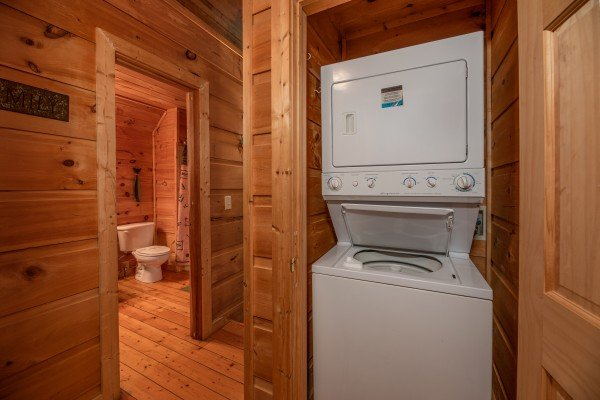 Stacked washer and dyer at Logan's Smoky Den, a 2 bedroom cabin rental located in Pigeon Forge