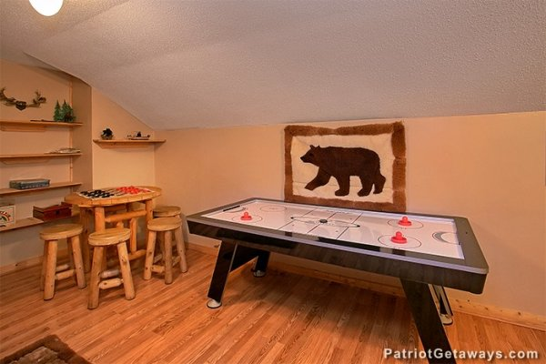Air hockey table and checker board game at Bear Creek, a 4-bedroom cabin rental located in Pigeon Forge