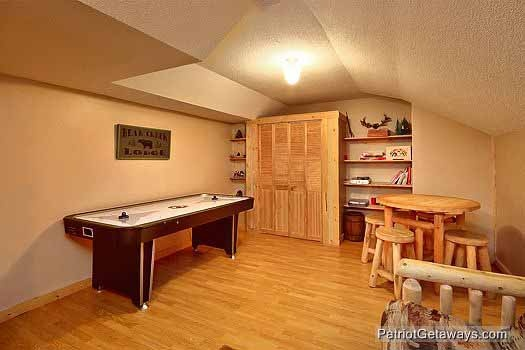air hockey table in first floor room at bear creek a 4 bedroom cabin rental located in pigeon forge