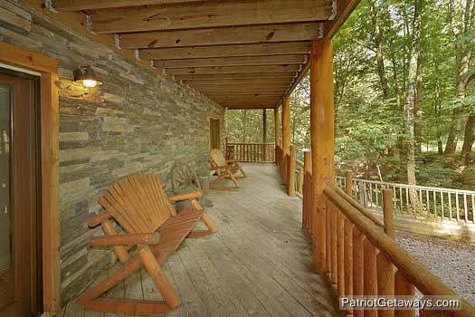 Seating on deck of first floor at Bear Creek, a 4-bedroom cabin rental located in Pigeon Forge