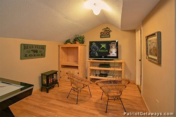 Game room Xbox gaming system at Bear Creek, a 4-bedroom cabin rental located in Pigeon Forge