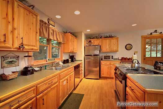 Kitchen with stainless appliances at at Bear Creek, a 4-bedroom cabin rental located in Pigeon Forge