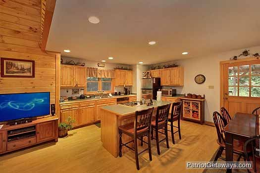 kitchen island with bar stools at bear creek a 4 bedroom cabin rental located in pigeon forge