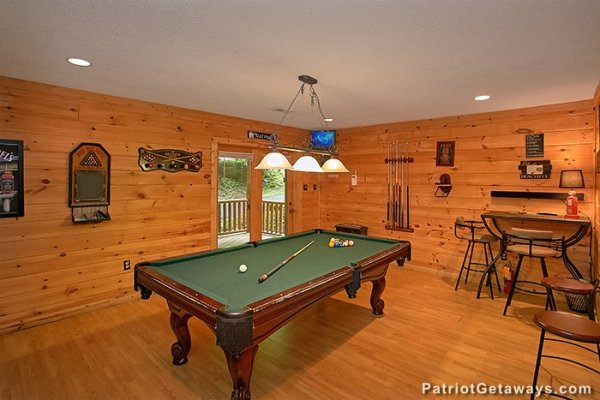 Green felted pool table in the game room at Bear Creek, a 4-bedroom cabin rental located in Pigeon Forge