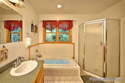 jacuzzi tub and shower in third floor bathroom at bear creek a 4 bedroom cabin rental located in pigeon forge