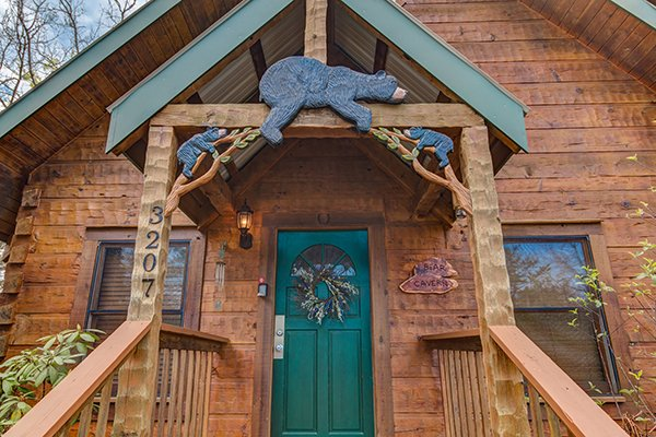 Custom woodwork entry at Bear Cavern, a 1-bedroom cabin rental located in Pigeon Forge