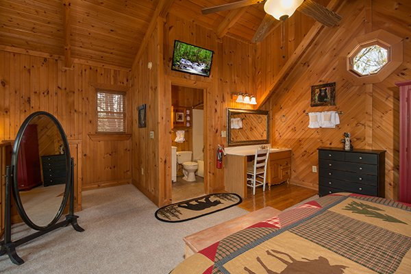 Loft bedroom with en suite and television at Bear Cavern, a 1-bedroom cabin rental located in Pigeon Forge
