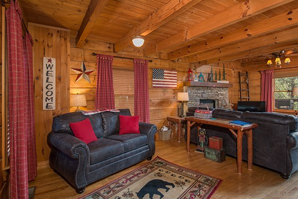 Living room seating at Bear Cavern, a 1-bedroom cabin rental located in Pigeon Forge