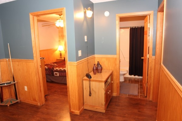 bedroom and bathroom off game room at just hanging out a 3 bedroom cabin rental located in pigeon forge