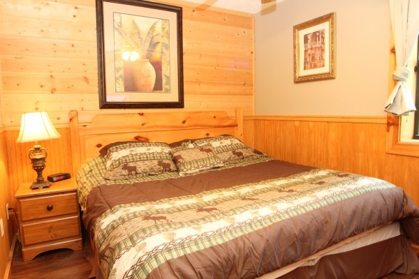 bedroom with king bed at just hanging out a 3 bedroom cabin rental located in pigeon forge