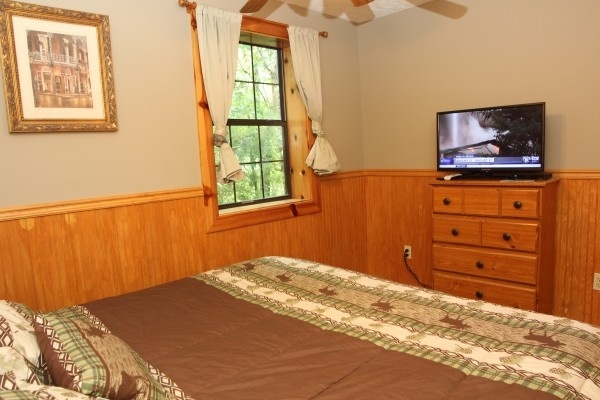 tv in the bedroom at just hanging out a 3 bedroom cabin rental located in pigeon forge