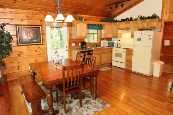dining and kitchen at just hanging out a 3 bedroom cabin rental located in pigeon forge