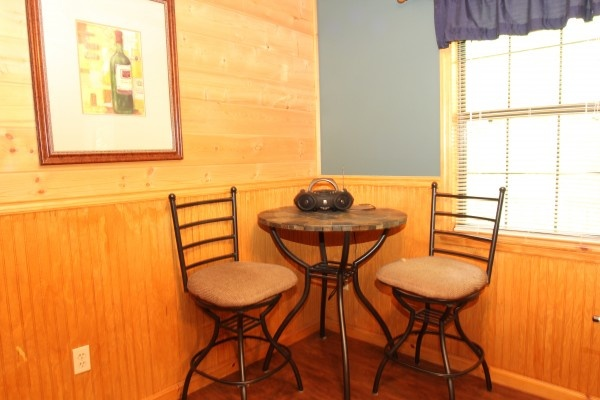 bistro table and chairs in the game room at just hanging out a 3 bedroom cabin rental located in pigeon forge