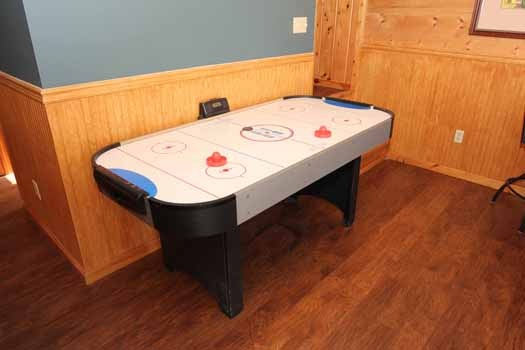 air hockey in game room at just hanging out a 3 bedroom cabin rental located in pigeon forge