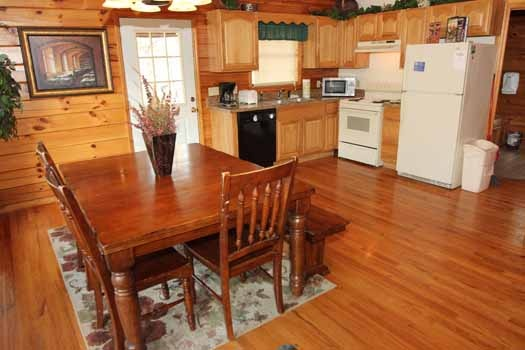 dining table next to kitchen at just hanging out a 3 bedroom cabin rental located in pigeon forge