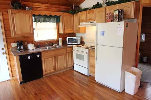 kitchen at just hanging out a 3 bedroom cabin rental located in pigeon forge