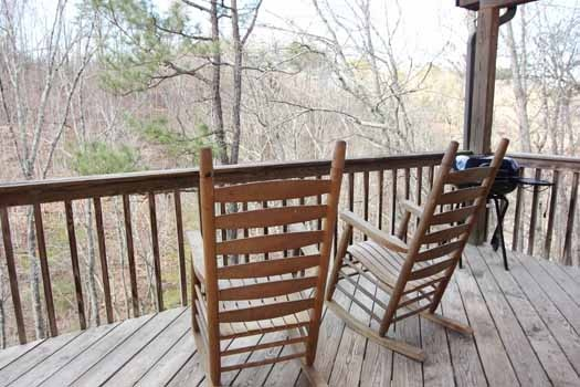 rocking chairs on the deck at just hanging out a 3 bedroom cabin rental located in pigeon forge