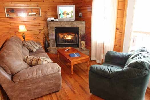living room at just hanging out a 3 bedroom cabin rental located in pigeon forge