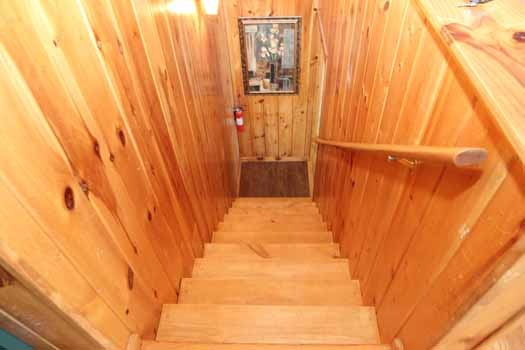 stairs to first floor at just hanging out a 3 bedroom cabin rental located in pigeon forge