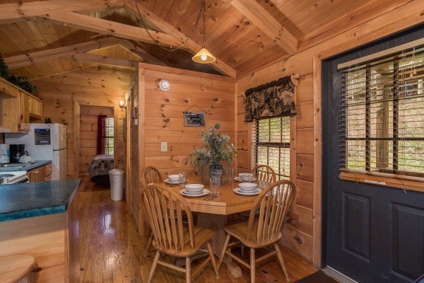 Dining table with seating for four at Boogie Bear, a 1-bedroom cabin rental located in Gatlinburg