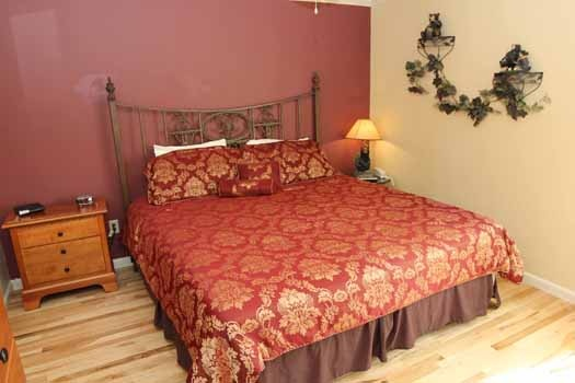 king sized bedroom at knotty & nice a 1 bedroom cabin rental located in gatlinburg