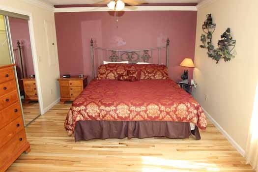 bedroom with king sized bed at knotty & nice a 1 bedroom cabin rental located in gatlinburg