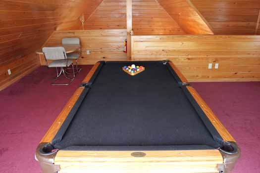 pool table in a lofted game room at knotty & nice a 1 bedroom cabin rental located in gatlinburg
