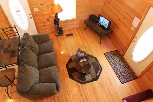 looking down into the living room from the loft at knotty & nice a 1 bedroom cabin rental located in gatlinburg
