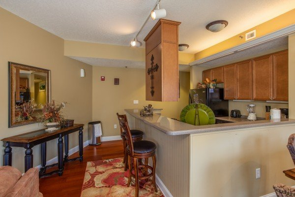 Breakfast bar with seating for two at Heart of Gatlinburg, a 2 bedroom cabin rental located in Gatlinburg
