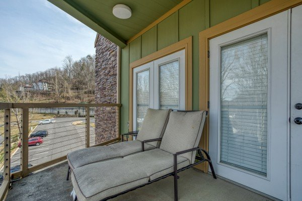 Chaise loungers on the balcony at Heart of Gatlinburg, a 2 bedroom cabin rental located in Gatlinburg