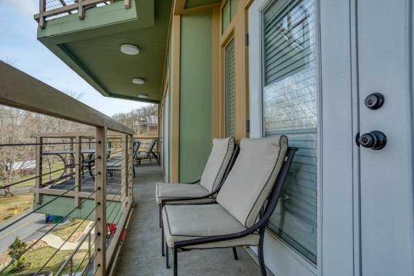 Two chairs on the balcony at Heart of Gatlinburg, a 2 bedroom cabin rental located in Gatlinburg