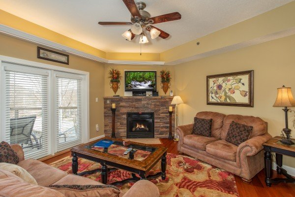 Fireplace and TV in the living room at Heart of Gatlinburg, a 2 bedroom cabin rental located in Gatlinburg