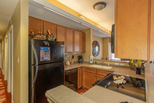 Kitchen with black appliances at Heart of Gatlinburg, a 2 bedroom cabin rental located in Gatlinburg