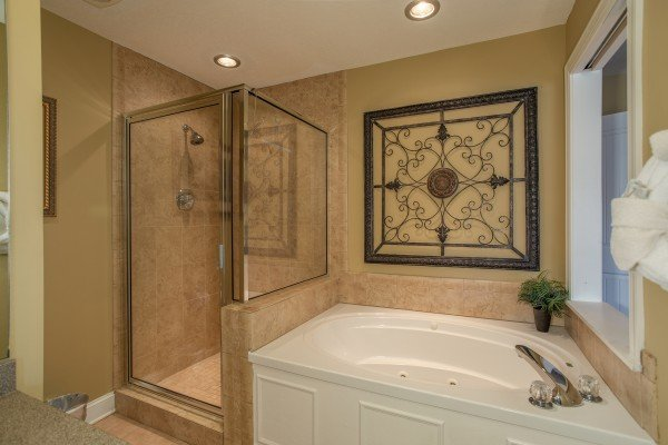 Bathroom with a walk in shower and jacuzzi tub at Heart of Gatlinburg, a 2 bedroom cabin rental located in Gatlinburg