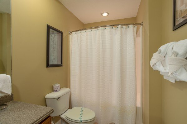 Bathroom with a tub and shower at Heart of Gatlinburg, a 2 bedroom cabin rental located in Gatlinburg