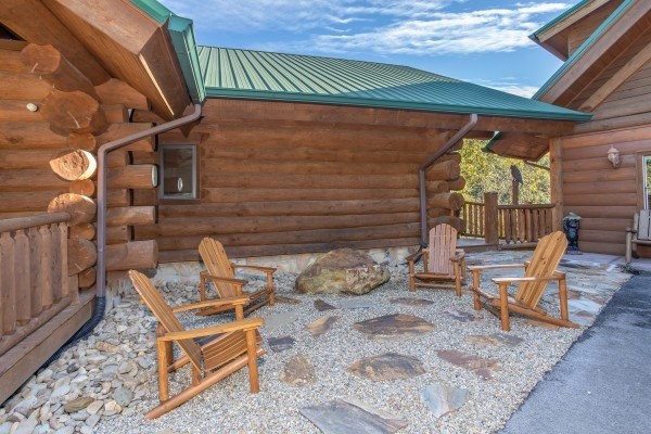 Four Adirondack chairs on a stone patio at Great View Lodge, a 5-bedroom cabin rental located in Pigeon Forge