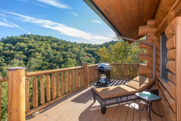 A chaise lounge on the deck overlooking the mountains at Great View Lodge, a 5-bedroom cabin rental located in Pigeon Forge