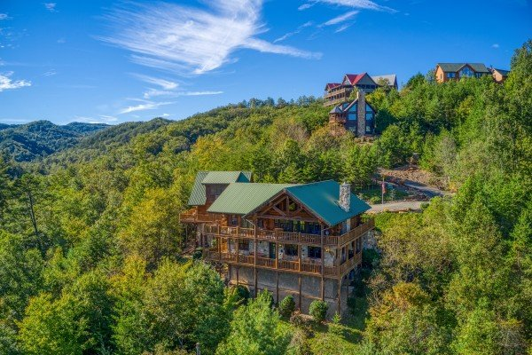 Looking at a cabin nestled in the hillside called Great View Lodge, a 5-bedroom cabin rental located in Pigeon Forge