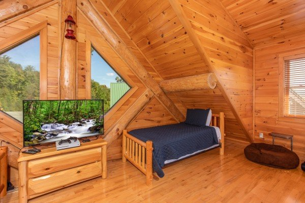 Large TV in the bunk room at Great View Lodge, a 5-bedroom cabin rental located in Pigeon Forge