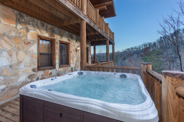 Hot tub with mountain views on an open deck at Great View Lodge, a 5-bedroom cabin rental located in Pigeon Forge