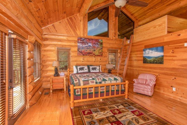 King bedroom with an additional sleeping loft at Great View Lodge, a 5-bedroom cabin rental located in Pigeon Forge