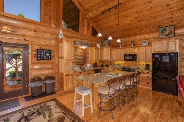 Kitchen with island and counter seating at Great View Lodge, a 5-bedroom cabin rental located in Pigeon Forge