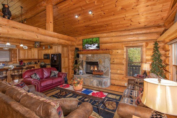 Fireplace and TV in the living room at Great View Lodge, a 5-bedroom cabin rental located in Pigeon Forge