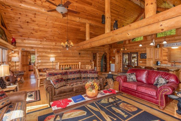 Living room with lots of seating and a sleeper sofa at Great View Lodge, a 5-bedroom cabin rental located in Pigeon Forge