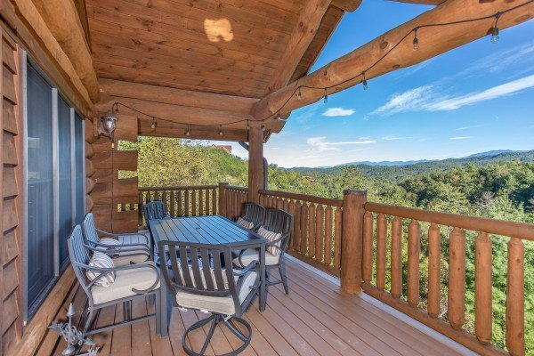 Mountain views from the dining space on the deck at Great View Lodge, a 5-bedroom cabin rental located in Pigeon Forge