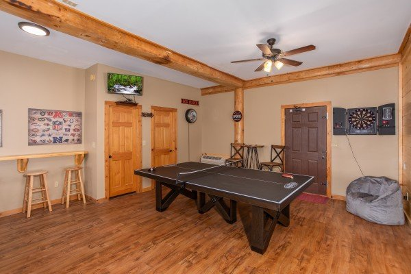 Ping pong table in the game room at Great View Lodge, a 5-bedroom cabin rental located in Pigeon Forge
