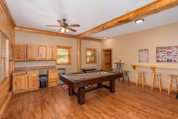 Pool table in the game room at Great View Lodge, a 5-bedroom cabin rental located in Pigeon Forge
