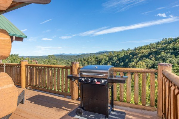 Propane grill on a deck overlooking the Smoky Mountains at Great View Lodge, a 5-bedroom cabin rental located in Pigeon Forge